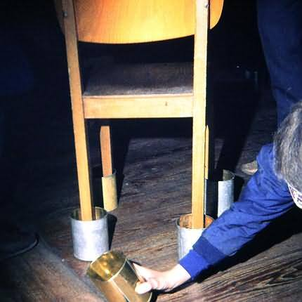 """blind"" game: cans under the chair leg"