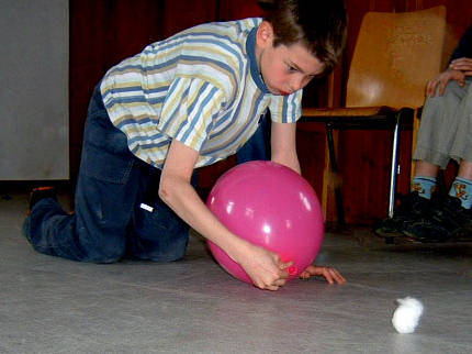 inflate a balloon and use it to move a cotton ball